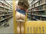 Toying wet cunt under library desk