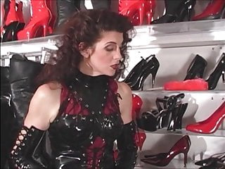 Small Tits Brunette Milf video: Rubber Boot Slut