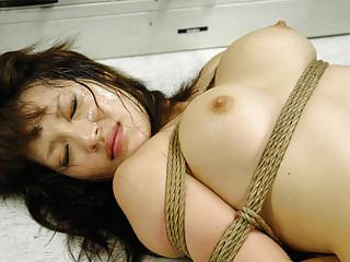 .Bound Asian hottie gets fucked with behind the bars.