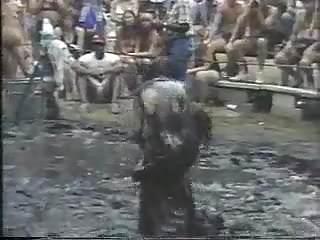 Nude ladies mud wrestle