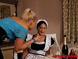 Dominatrix lesbian punishing her maid