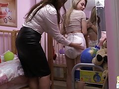 Betty changes Chloe's wet Attends Special Care diaper