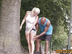Babe gets interracial cum
