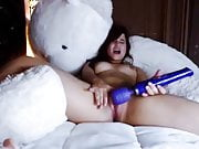 Cutie orgasms cradled by large Teddy Bear