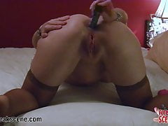MILF puts vibrators in her ass and pussy at same time