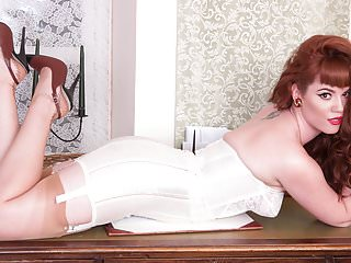 Redheads Striptease Redhead video: Redhead babe strip teases showing nyloned legs bare pussy