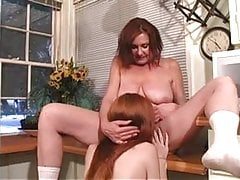 Anastasia Sands Seduces Young Redhead Teen