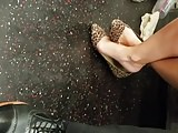 Candid working lady feet in flats