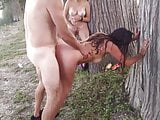 Swingers having sex in the forest
