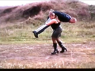 German Blondes movie: Hijacking a Guy by Over Shoulder Lift