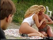 Guy joins couple of 2 girls on beach