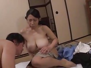 Japanese Cheating Mom video: Son gets horny watching mom. She helps him.