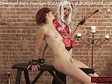 Skinny redhead spanked and waxed by her lesbian mistress