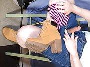 Enjoying myself in boots and a denim mini skirt