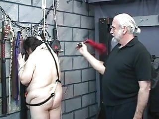 Thick girl is restrained by two bdsm dungeon...