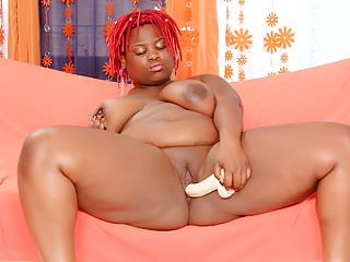Thick black girl uses sex toys...