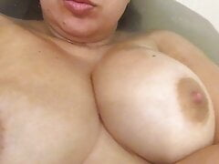 Hot milf Natalia Choyz plays with huge tits in whater