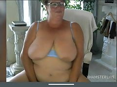 Granny with saggy tits masturbates pussy