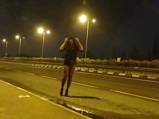 Shameless girl trying to hitchhike.