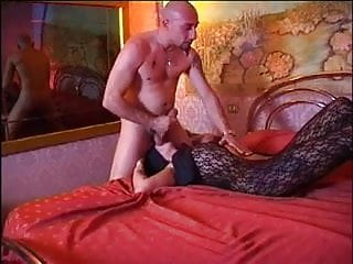 Gets fucked by hung bald guy on bed...