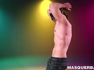 Masked hunky gay strips naked and strokes his cock