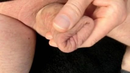 Mature Guy Spunking in his foreskin covered cock