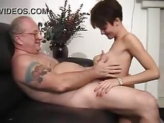 Young babe gives man blowjob...