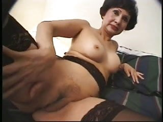 Mature asian woman strokes on hotel bed...