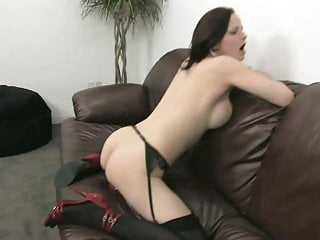 Brunette in sexy red lingerie masturbates solo with a toy