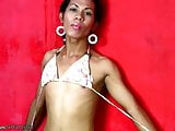 Tall Filipino t-girl takes off colorful lingerie and strokes