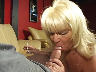 Blonde sucking granny enjoys a cigarette and a...