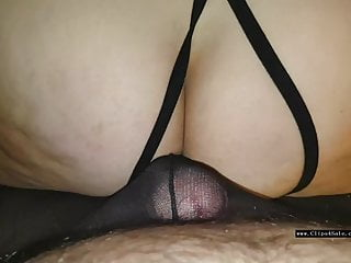 Wearing her nylons as she slides in crotchless panties