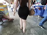 Huge ass in black tight skirt candid