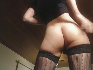 In stockings playing with butt...