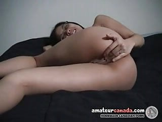 Geeky asian in glasses fingering wet pussy having fun