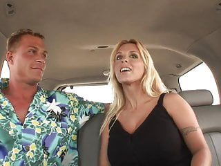 Blonde with huge tits moist in a car...
