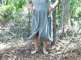 Pee on Green dress in maritime forest 1 - Video 161.mp4