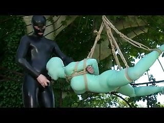 Girl with latex catsuit tied up,suspended and fucked