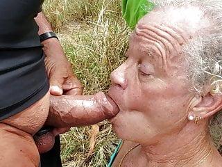 Crossdresser sucking big cock outdoors...