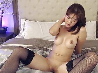 Asian Stockings video: Innocent Asian babe in stockings fetish