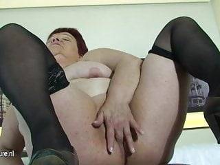 Big mama sure loves her hard dildo