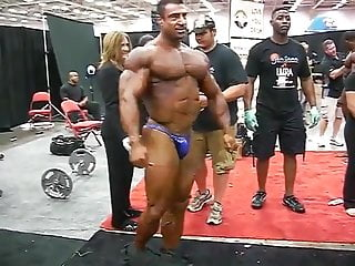 Str8 greek bodybuilder flexing in backstage...