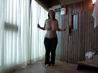 Busty babe jumping rope topless...