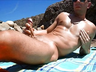 Sunbathing and jerking at the...