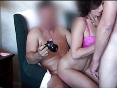 Swinging couple having a threesome
