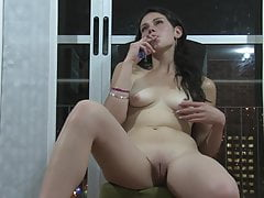 Sexy smoking by naked brunette