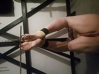 Caning my slaves feet!