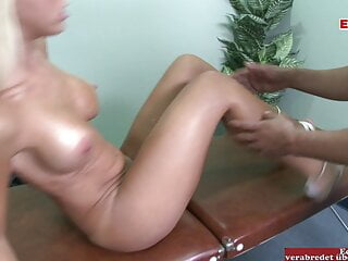 Blonde slut with perfect tits fucked on the massage table