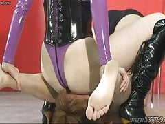 A mistress whipping a slave or sitting on the face