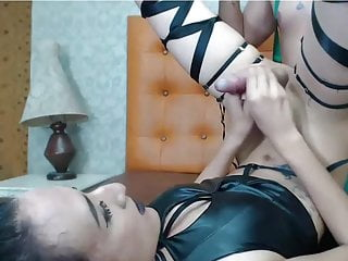 Hot leather shemale does a self facial with...